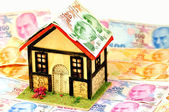 Miniature house and money — Stock Photo