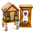 Hourglass, home, money - Foto Stock