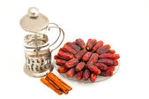 Date and cinnamon isolated — Stock Photo