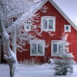 Snowy cottage in Smaland (Sweden) - Stock Photo