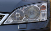 Close-up view of front lights of a modern car — Stock Photo