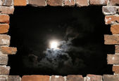 Old brick wall as a grungy frame with night heaven — Stock Photo