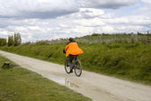 Man on bike — Stock Photo