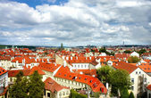 Prague roofs and cloudy sky — Stock Photo