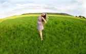 Young woman and green fields — Stock Photo
