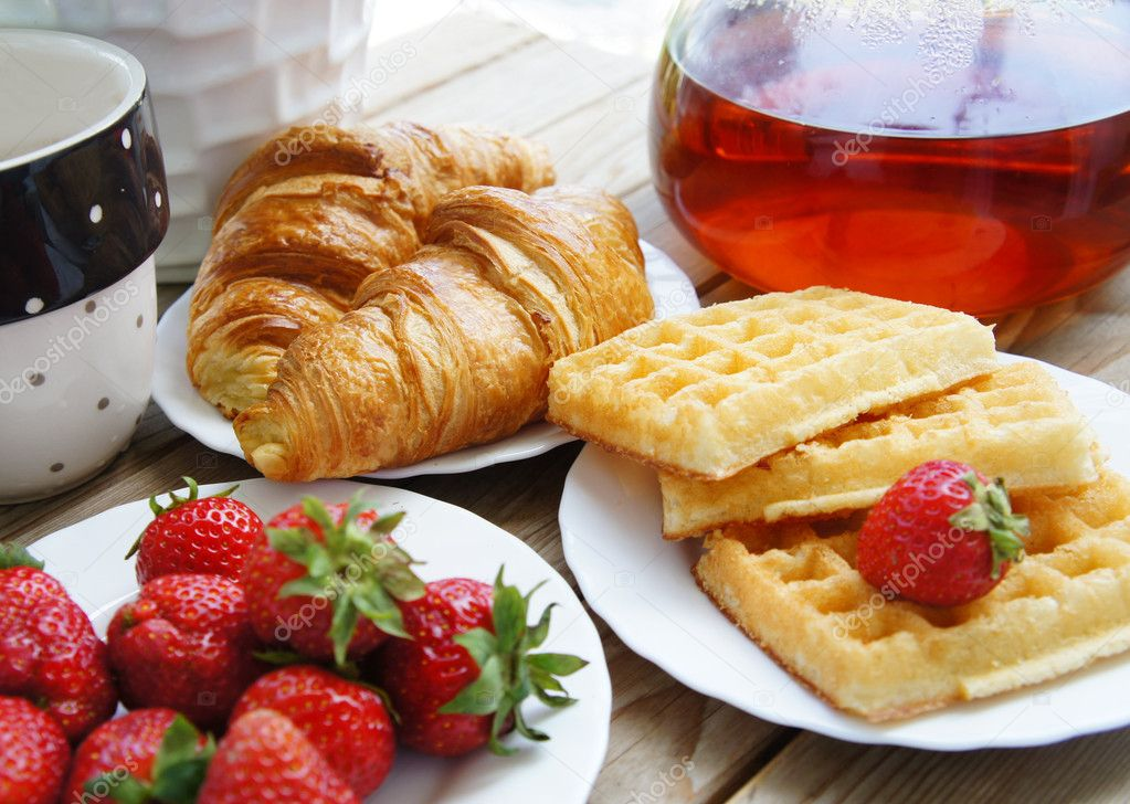 http://static9.depositphotos.com/1605515/1138/i/950/depositphotos_11389987-stock-photo-tasty-breakfast-tea-croissants-wafers.jpg