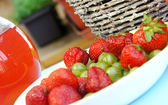 Strawberries, gooseberry, basket and compote — Stock Photo