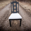 Stock Photo: Empty Chair On Dirt Road