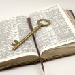 Opened Bible With Golden Key — Stock Photo
