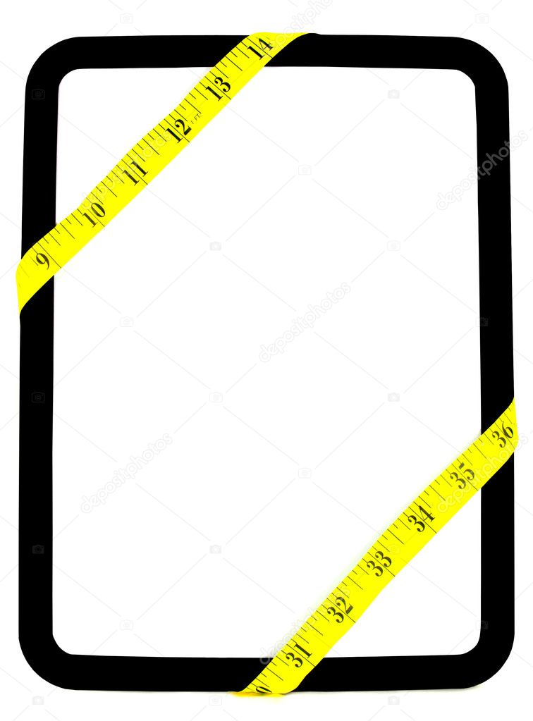 Yellow weight measuring tape wrapped around white and black dry erase background board  Stok fotoraf #10807481