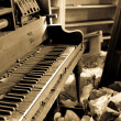Stock Photo: Dirty Piano With Trashed Furniture