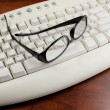 Reading Glasses On White Keyboard — Stockfoto #10812033