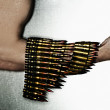 Stock Photo: Man's hand in machine-gun tapes