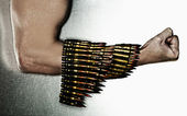 Man's hand in machine-gun tapes — Stock Photo