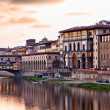 Sunset on Ponte Vecchio in Florence - Stok fotoğraf