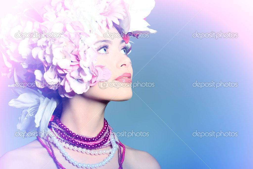 Portrait of a beautiful spring girl wearing flowers hat. Studio shot. — Stock Photo #10768571