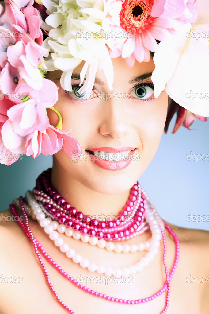 Portrait of a beautiful spring girl wearing flowers hat. Studio shot.  Stock Photo #10768577