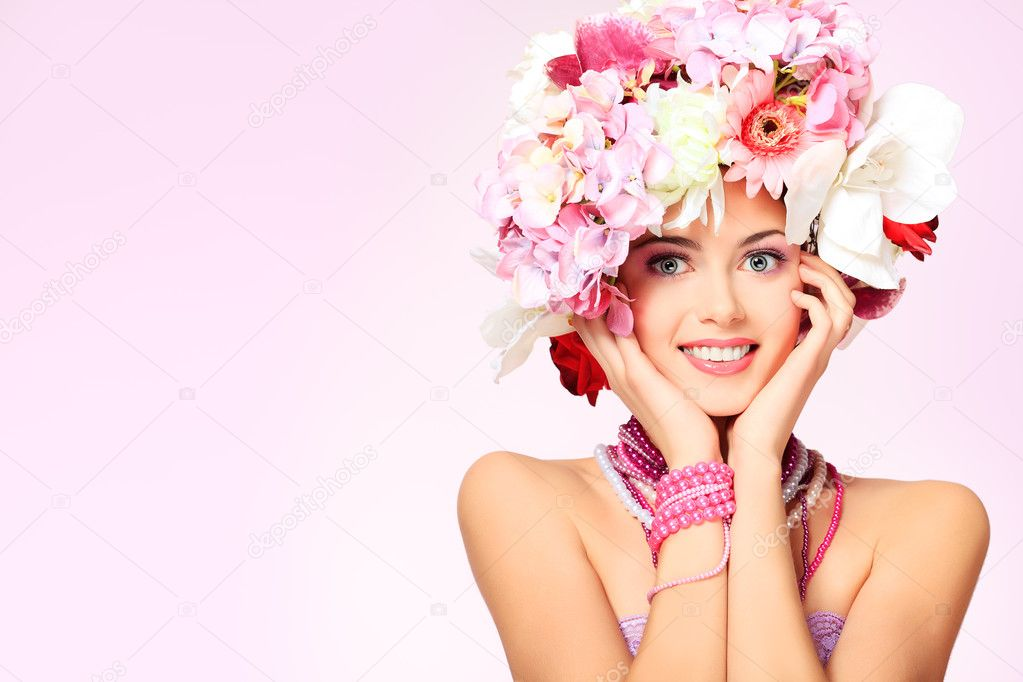 Portrait of a beautiful spring girl wearing flowers hat. Studio shot.  Stock Photo #10768580