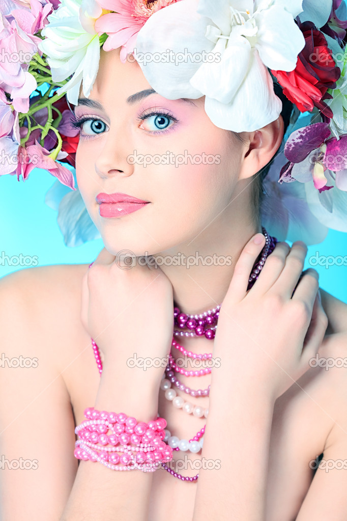Portrait of a beautiful spring girl wearing flowers hat. Studio shot.  Photo #10768592