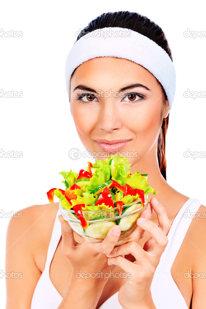 Portrait of a beautiful young woman eating vegetable salad. Isolated over white background. — Stock Photo #10768629