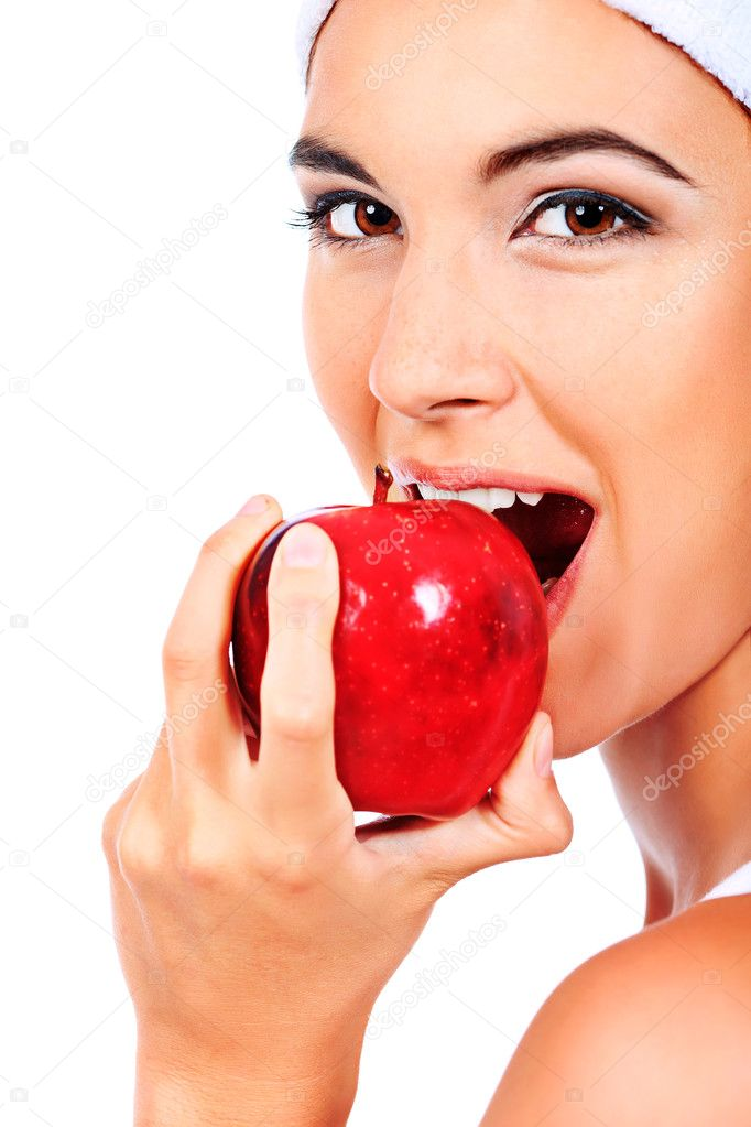 Portrait of a beautiful young woman with fresh red apple. Isolated over white background. — Stock Photo #10768630
