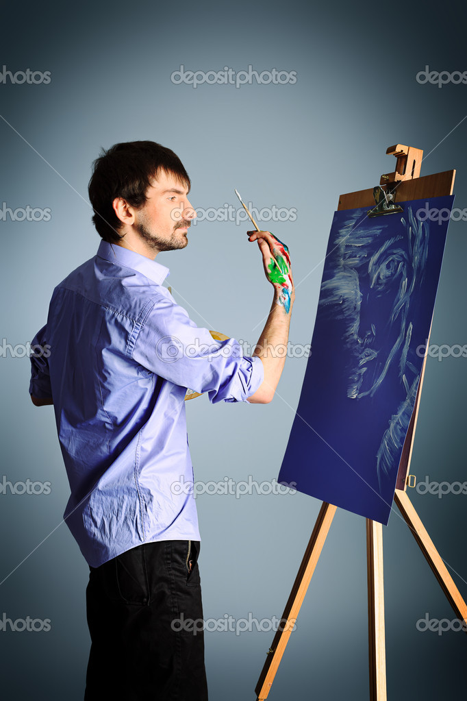 Portrait of an artist painting on easel. Shot in a studio. — Stock Photo #10768670