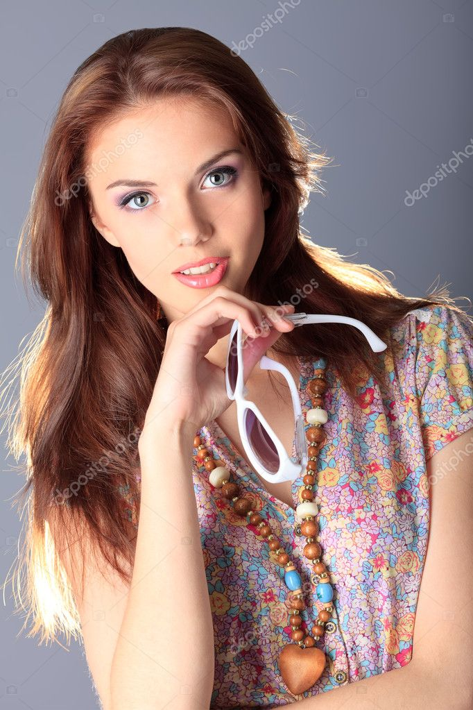 Shot of a beautiful girl in summer style posing at studio.  Stock Photo #10768895