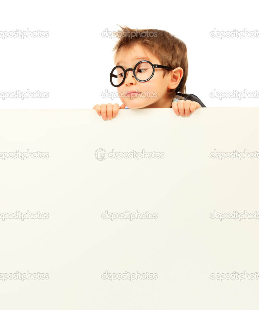 Portrait of a little boy in spectacles with white board. Isolated over white background.  Stock Photo #10845885