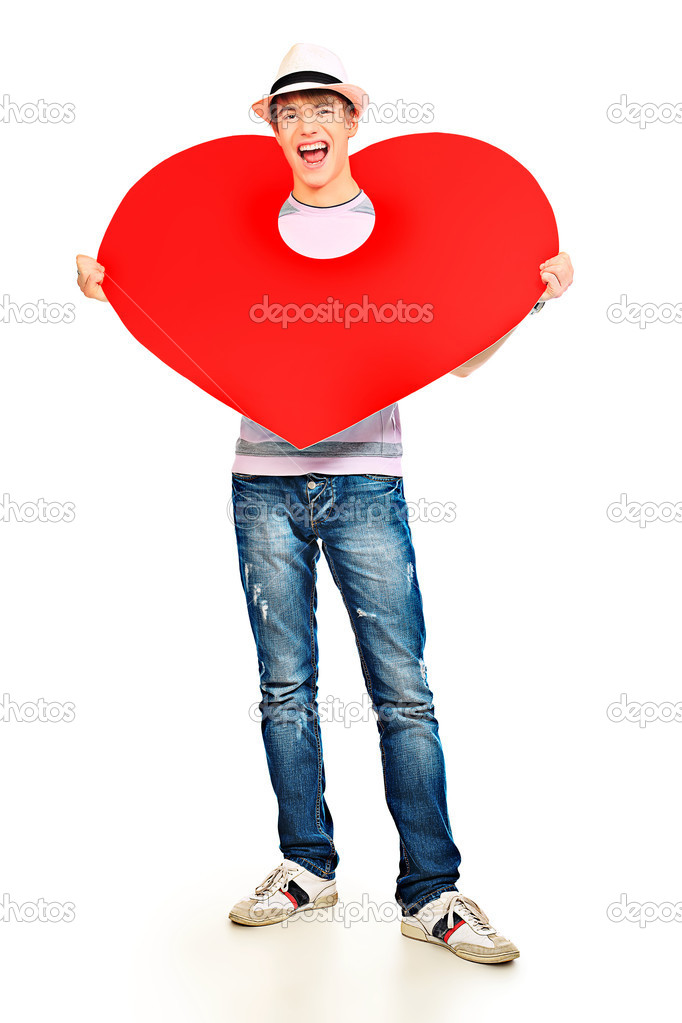 Handsome young man posing with big red heart. Isolated over white background.  Stock Photo #10952324