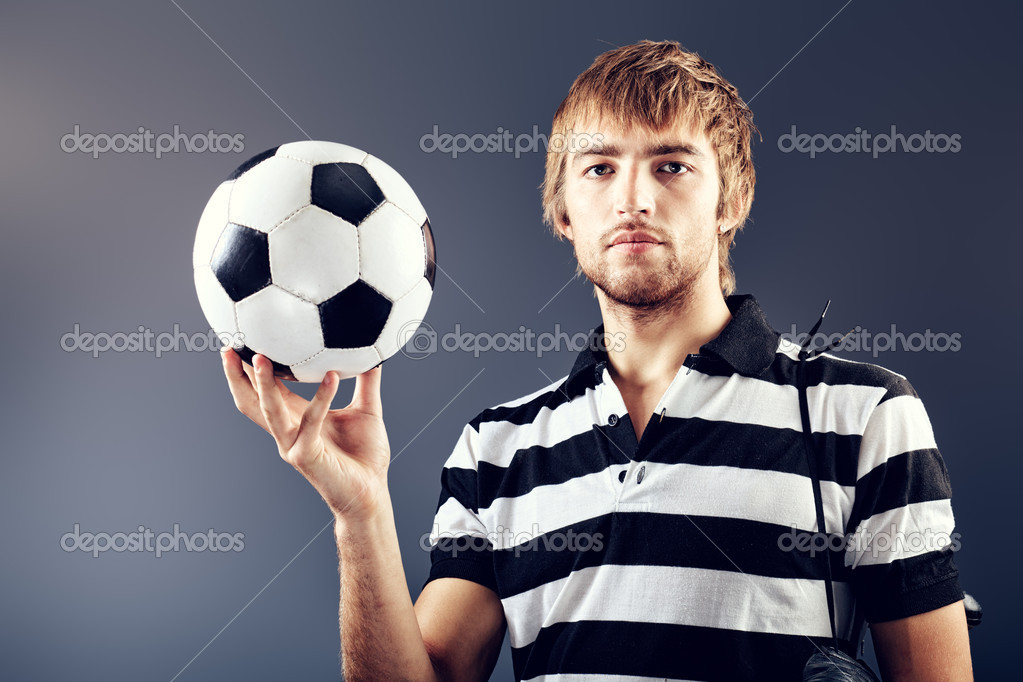 Portrait of a handsome soccer player. Studio shot.  Stock Photo #10952410
