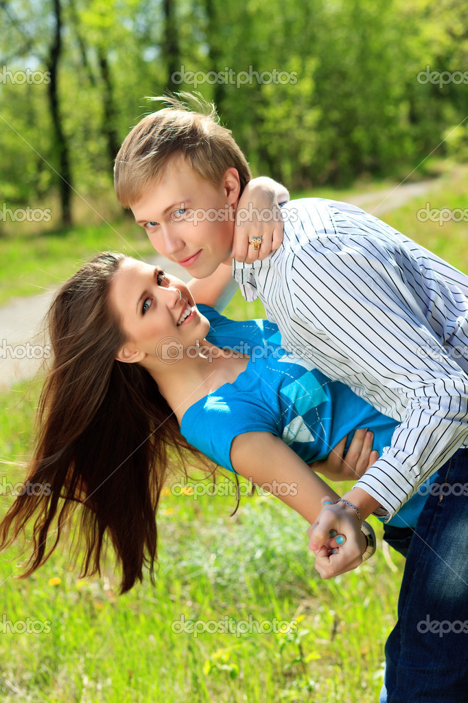 Beautiful young couple spending a time together outdoor. — Stock Photo #10952418