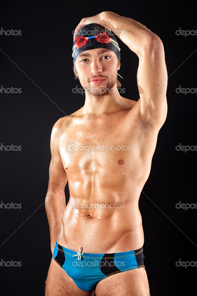 Portrait of a man professional  swimmer over black bakground. — Stock Photo #10952488