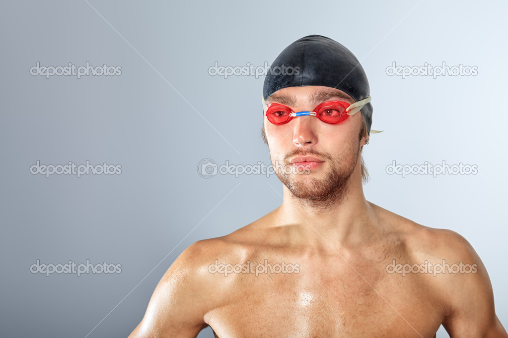 Portrait of a man professional  swimmer posing at studio. — Stock Photo #10952501
