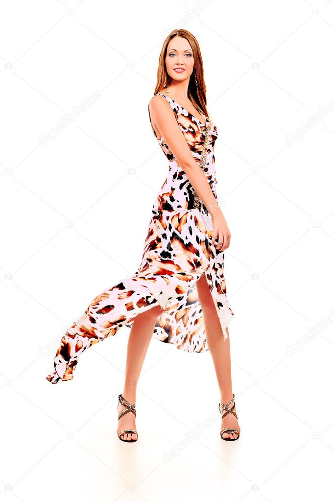 Fashionable young woman in beautiful dress posing at studio. Isolated over white.  Stock Photo #10972904