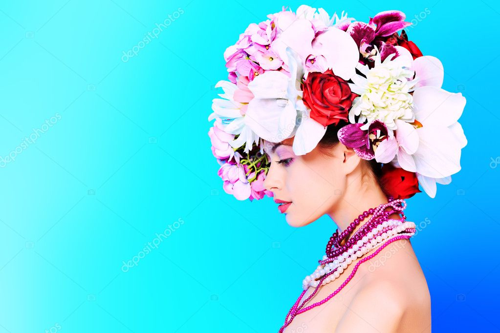 Portrait of a beautiful spring girl wearing flowers hat. Studio shot.  Stock Photo #10972957