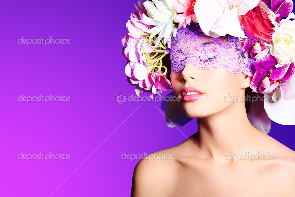 Portrait of a beautiful spring girl wearing flowers hat. Studio shot. — Stock Photo #10995833