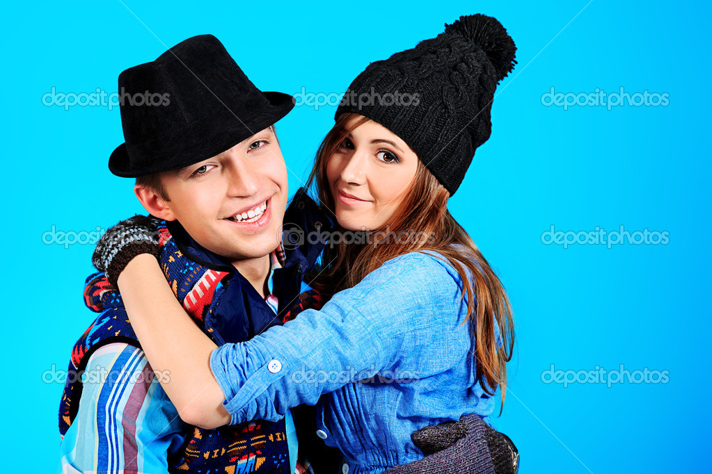 Portrait of a happy young couple in warm clothes. — Stock Photo #10996052
