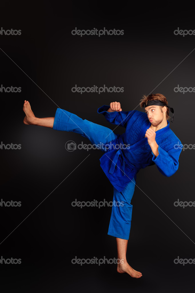 Martial arts fighter posing at studio. — Stock Photo #11013544