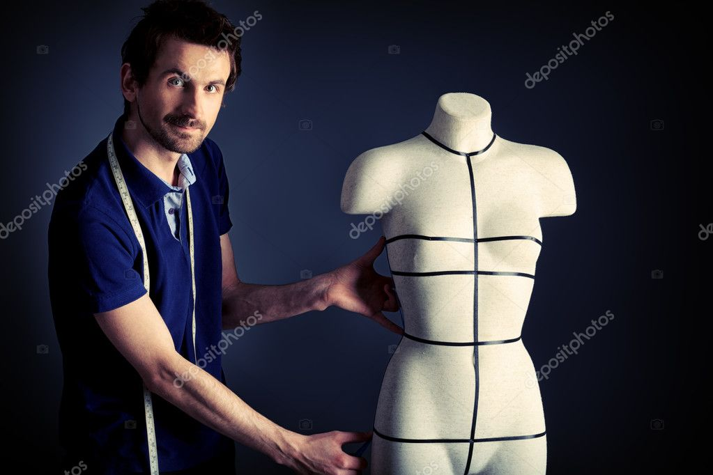 Portrait of a man fashion designer working with dummy at studio. — Stock Photo #11013593