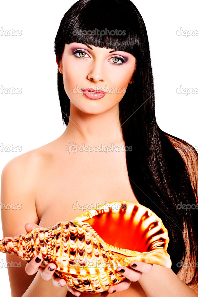 Beautiful young woman posing with marine shell. Spa, healthcare. Isolated over white. — Stock Photo #11013700