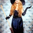 Charming halloween witch in hat — Stock Photo #11144087