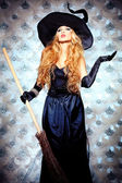 Charming halloween witch in hat — Stock Photo