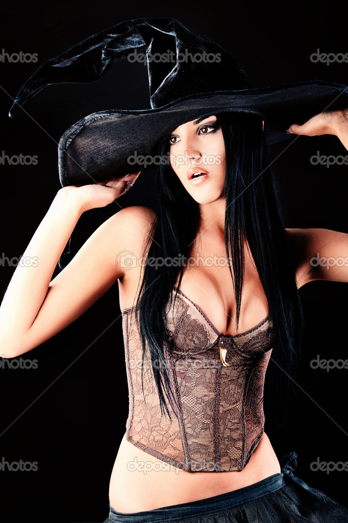 Charming halloween witch over black background. — Stock Photo #11144015