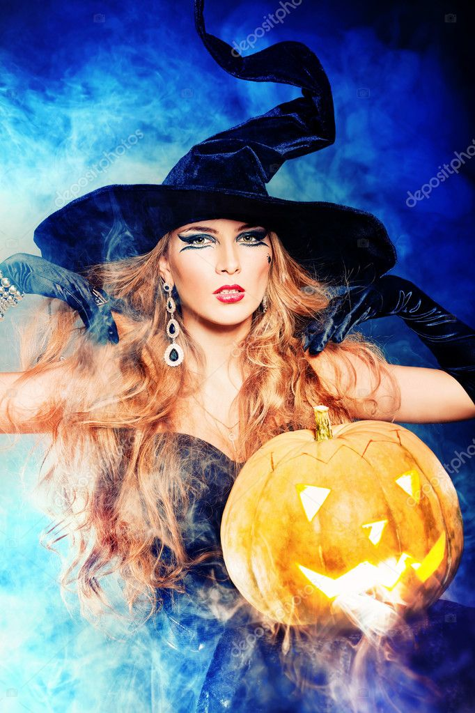 Charming halloween witch over black background. — Stock Photo #11144247