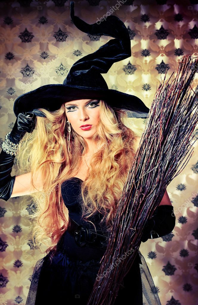 Charming halloween witch with broom over vintage background. — Stock Photo #11144257