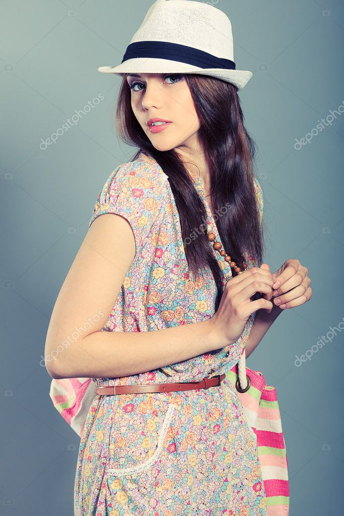 Shot of a beautiful girl in summer style posing at studio.  Stock Photo #11361253