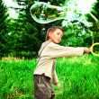 Stock Photo: Making bubbles
