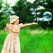 Stock Photo: Catching bubbles