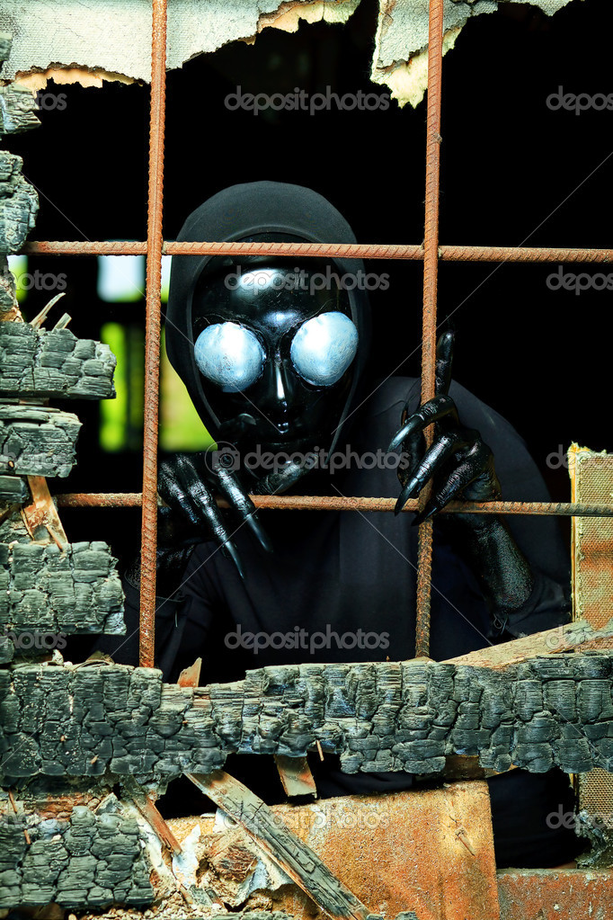 Scary alien creature in an abandoned house. Halloween, horror. — Stock Photo #11501046