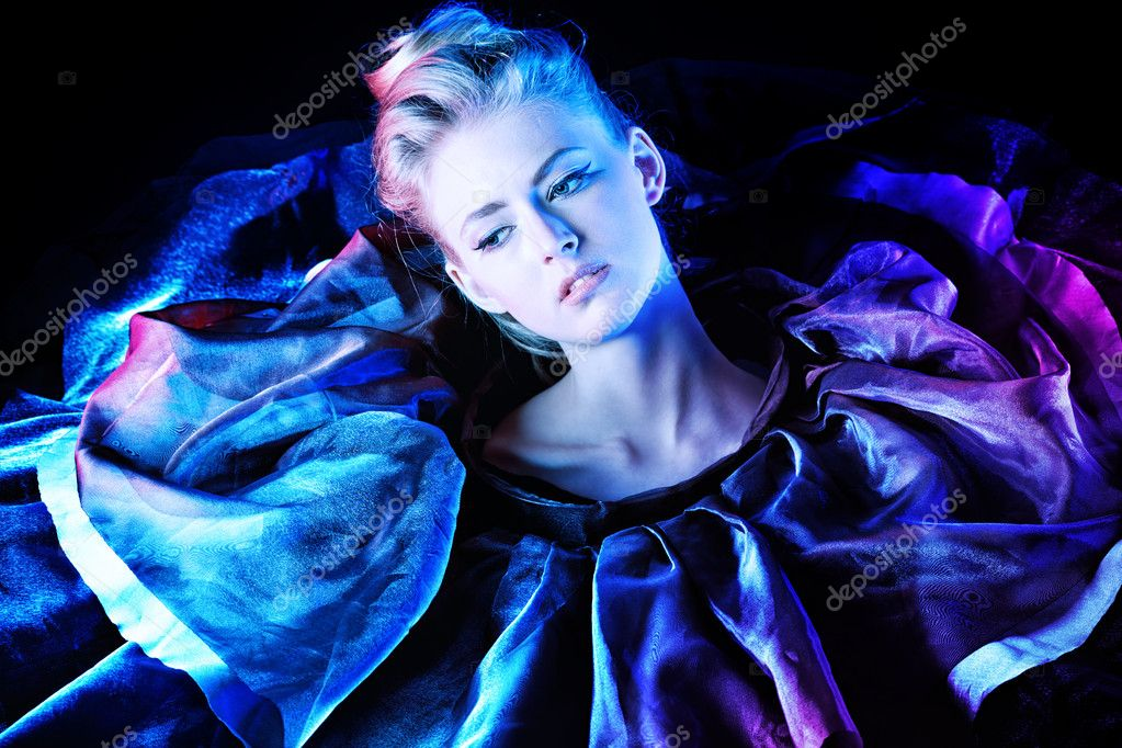 Art fashion photo of a beautiful model. Over black background.  Stock Photo #11509553